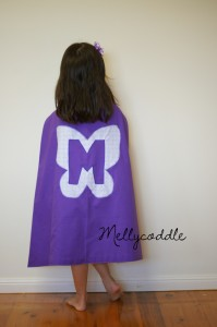 Trying the superhero cape on